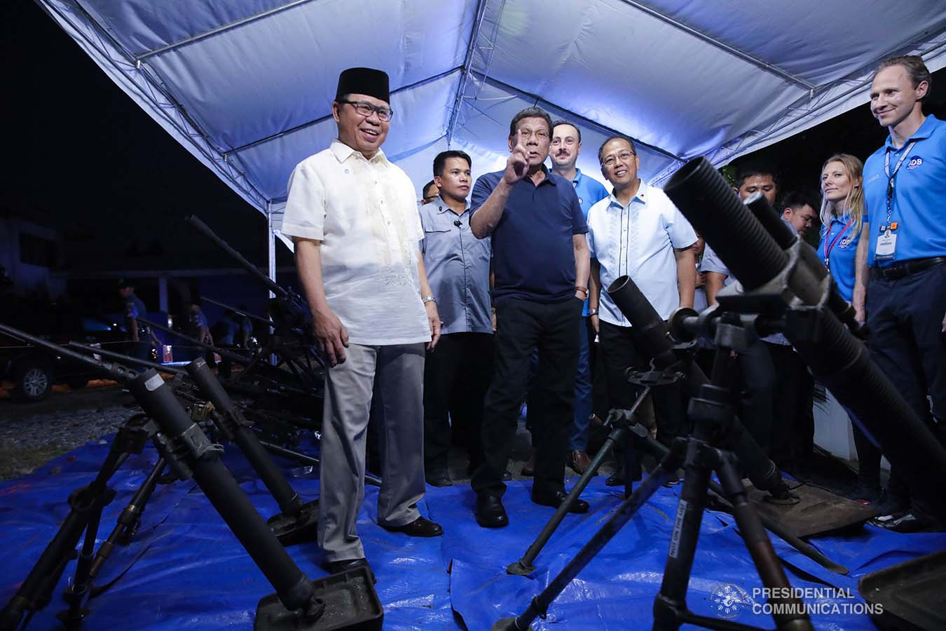 President Rodrigo Roa Duterte inspects the decommissioned firearms from the former combatants of the Moro Islamic Liberation Front during their decommissioning at the Old Provincial Capitol Compound in Sultan Kudarat, Maguindanao on September 7, 2019. ROBINSON NIÑAL JR./PRESIDENTIAL PHOTO