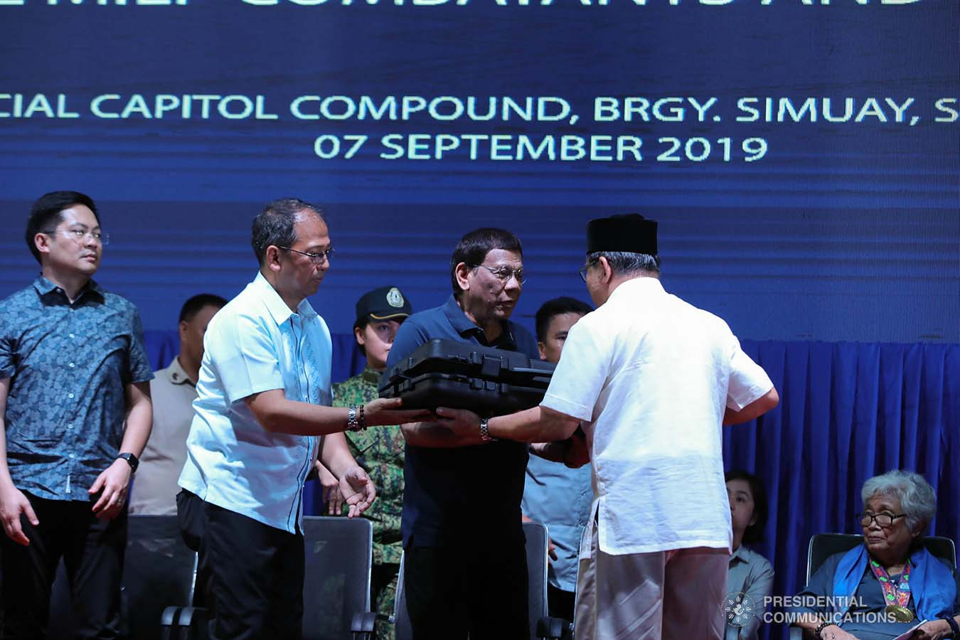 President Rodrigo Roa Duterte receives a token from Bangsamoro Autonomous Region in Muslim Mindanao (BARMM) Interim Chief Minister Al Haj Murad Ebrahim during the launch of the second phase of the decommissioning of Moro Islamic Liberation Front combatants and weapons at the Old Provincial Capitol Compound in Sultan Kudarat, Maguindanao on September 7, 2019. ROBINSON NIÑAL JR./PRESIDENTIAL PHOTO