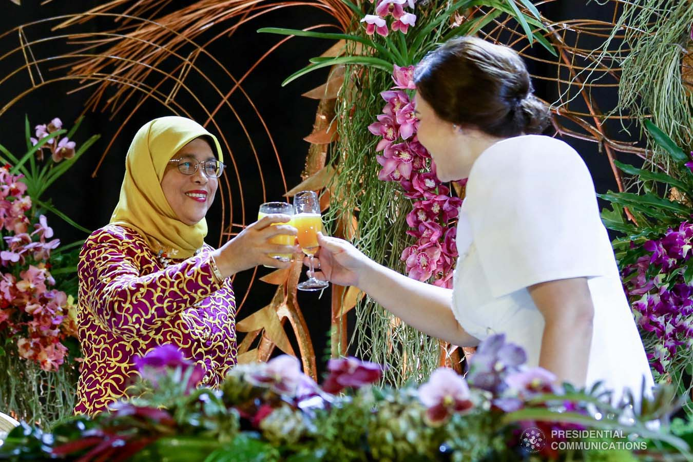 Republic of Singapore President Halimah Yacob and Davao City Mayor Sara Duterte-Carpio clink their glasses for a toast during the dinner hosted by the Mayor at the Marco Polo Davao on September 10, 2019. RICHARD MADELO/PRESIDENTIAL PHOTO