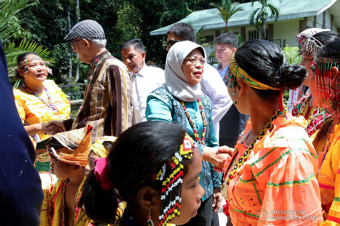 Republic of Singapore President Halimah Yacob greets the cultural performers who entertained her during her visit to the Philippine Eagle Center in Davao City on September 11, 2019. ROBINSON NIÑAL JR./PRESIDENTIAL PHOTO
