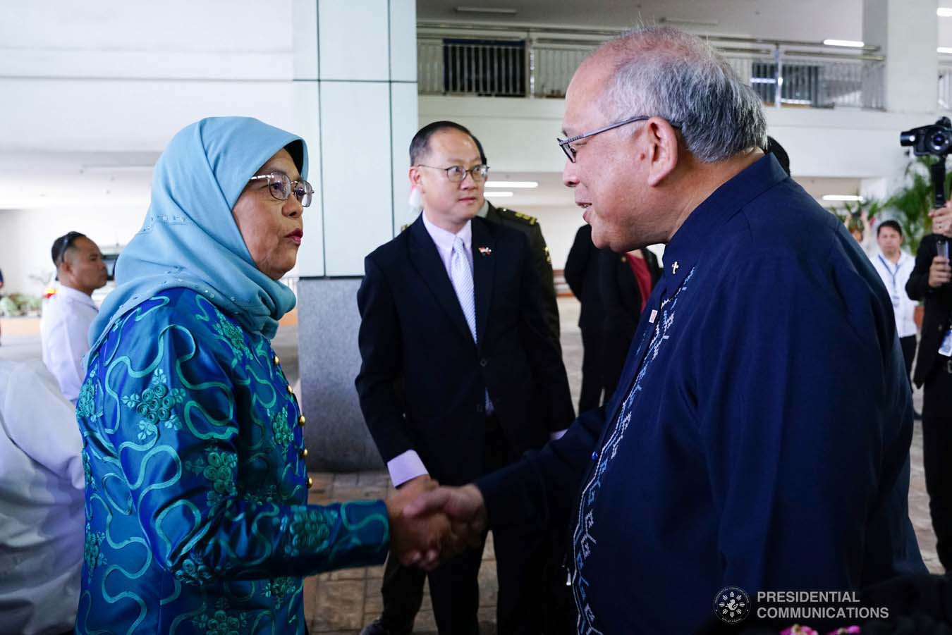 Republic of Singapore President Halimah Yacob receives a warm welcome from Ateneo de Davao University (ADDU) President Joel Tabora upon her arrival at the ADDU in Davao City on September 11, 2019. JOEY DALUMPINES/PRESIDENTIAL PHOTO