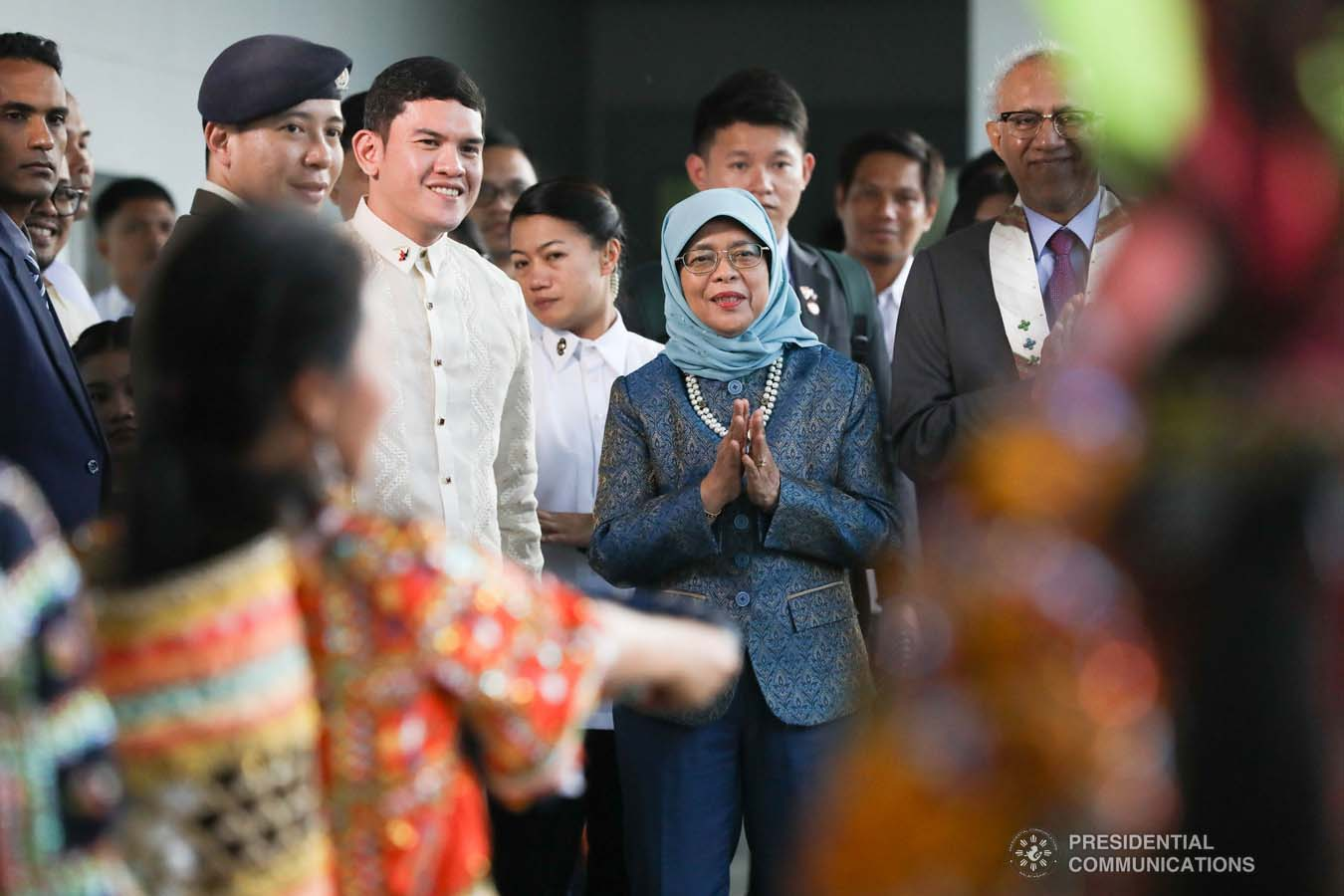 Republic of Singapore President Halimah Yacob admires the cultural performers who entertained her upon her arrival at the Davao International Airport in Davao City on September 10, 2019. Accompanying the Singaporean President is Davao City Vice Mayor Sebastian Duterte. KARL NORMAN ALONZO/PRESIDENTIAL PHOTO