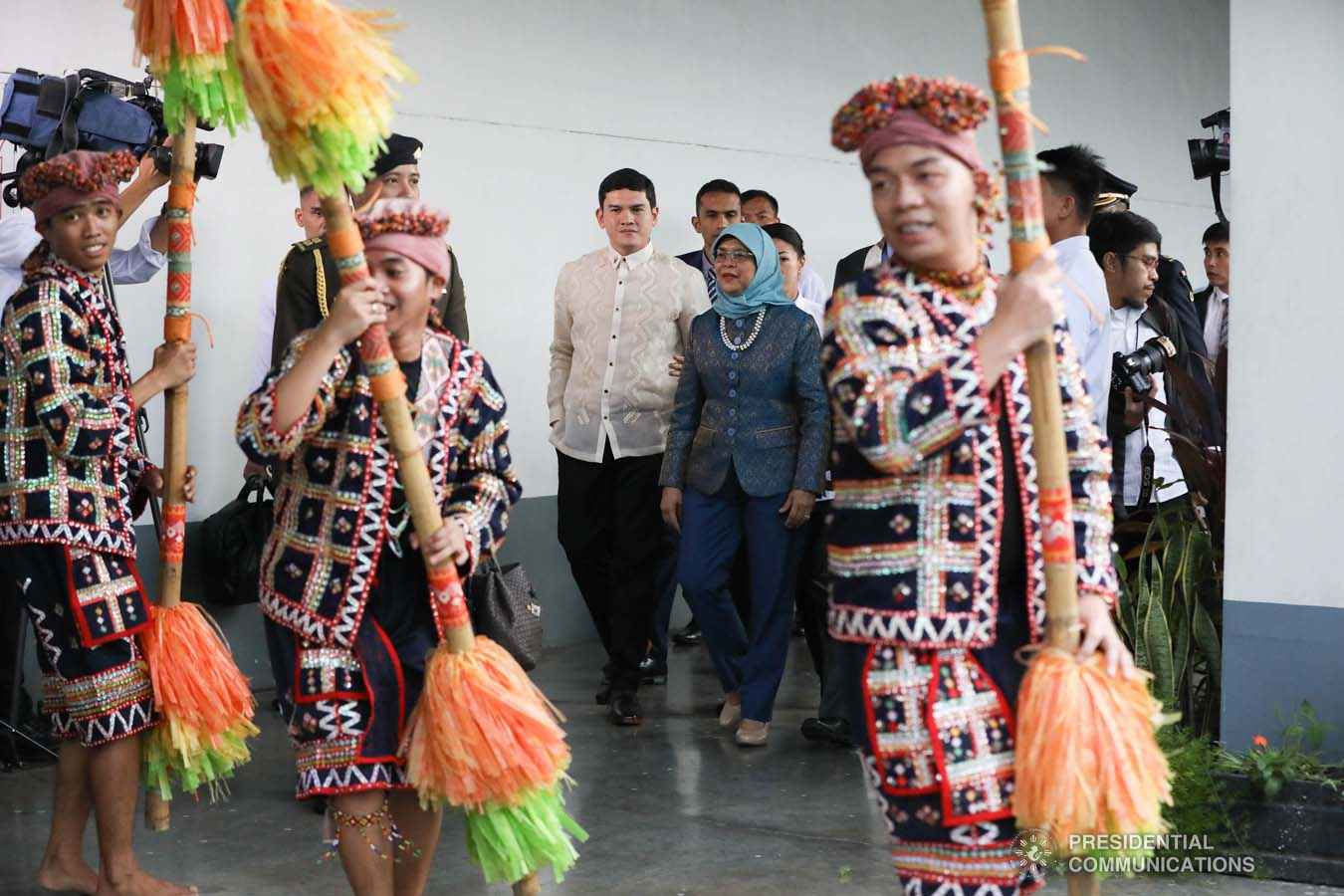 Republic of Singapore President Halimah Yacob is accompanied by Davao City Vice Mayor Sebastian Duterte as she is entertained by cultural performers upon her arrival at the Davao International Airport in Davao City on September 10, 2019. KARL NORMAN ALONZO/PRESIDENTIAL PHOTO