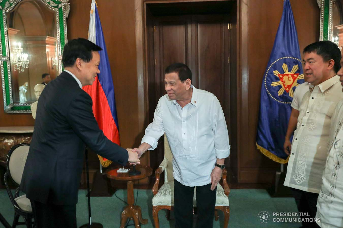 President Rodrigo Roa Duterte gives a warm welcome to Communist Party of China (CPC) Chongqing Party Chief Chen Min'er who paid a courtesy call on the President at the Malacañan Palace on September 16, 2019. ACE MORANDANTE/PRESIDENTIAL PHOTO