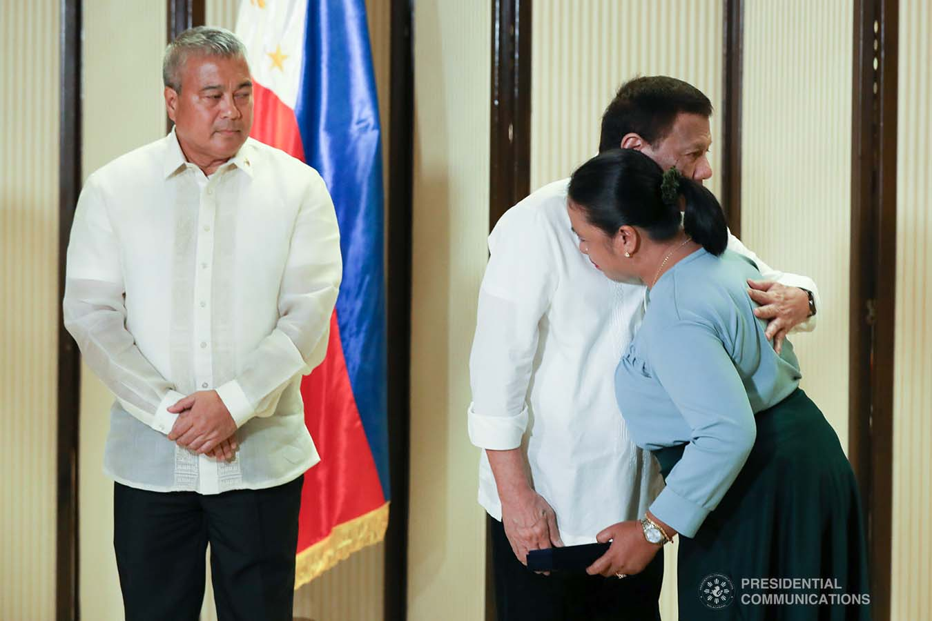 President Rodrigo Roa Duterte condoles with the kin of one of the killed soldiers as he posthumously awards the Order of Lapu-Lapu Rank of Kalasag during a ceremony at the Malacañan Palace on September 17, 2019. TOTO LOZANO/PRESIDENTIAL PHOTO