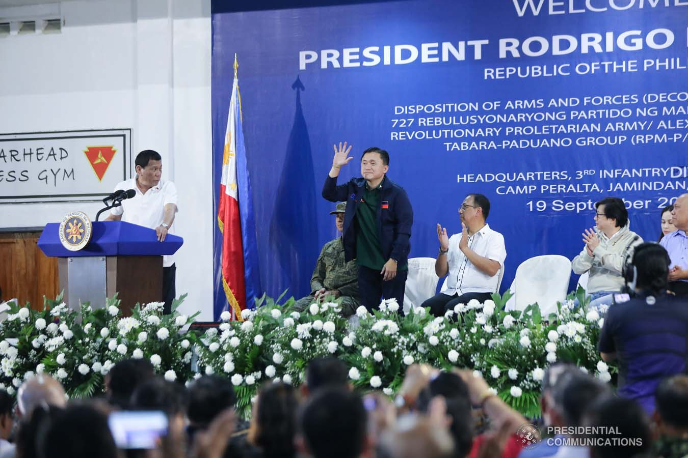"""President Rodrigo Roa Duterte recognizes the presence of Senator Christopher """"Bong"""" Go as he delivers his speech during the decommissioning of the arms and forces of the 727 Rebolusyonaryong Partido ng Manggagawa - Pilipinas/ Revolutionary Proletarian Army/ Alex Boncayao Brigade - Tabara-Paduano Group (RPM-P/RPA/ABB-TPG) at the Camp General Macario B. Peralta, Jr. in Jamindan, Capiz on September 19, 2019. ALFRED FRIAS/PRESIDENTIAL PHOTO"""