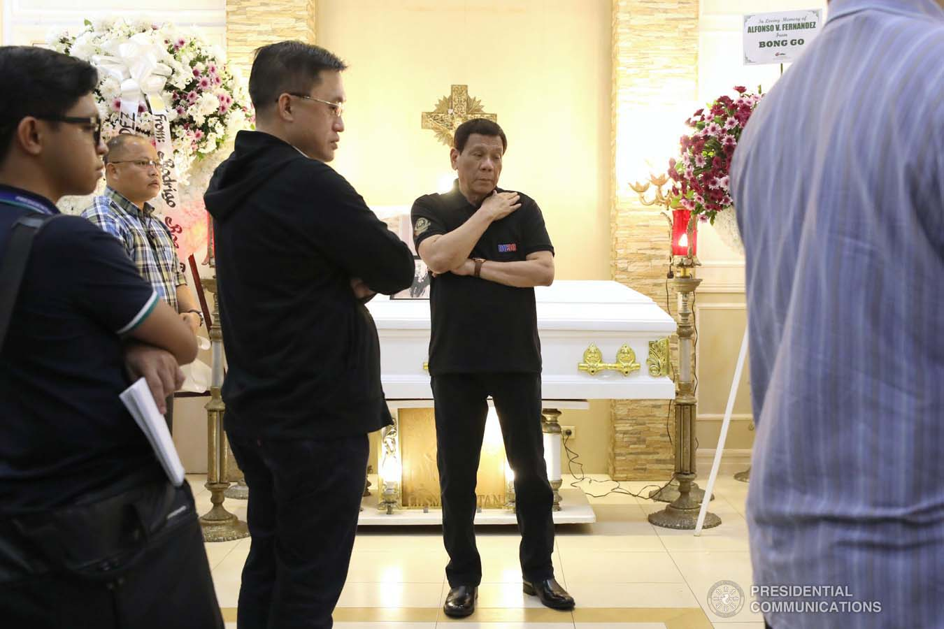 President Rodrigo Roa Duterte condoles with the family of Alfonso Fernandez as he visits the wake at the Cosmopolitan Funeral Homes in Davao City on September 21, 2019. KARL NORMAN ALONZO/PRESIDENTIAL PHOTO
