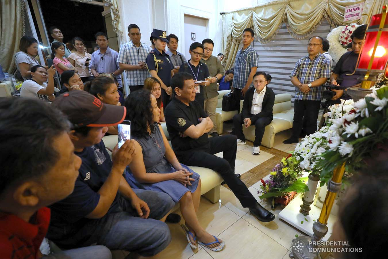 President Rodrigo Roa Duterte condoles with the family of Zianne Paraiso as he visits the wake at the Cosmopolitan Funeral Homes in Davao City on September 21, 2019. KARL NORMAN ALONZO/PRESIDENTIAL PHOTO