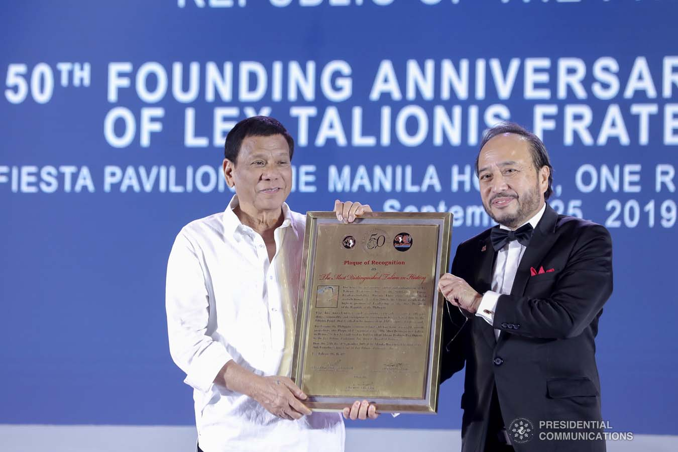 President Rodrigo Roa Duterte receives a plaque of recognition during the 50th Founding Anniversary Celebration of Lex Talionis Fraternitas Inc. at The Manila Hotel on September 25, 2019. ALFRED FRIAS/PRESIDENTIAL PHOTO
