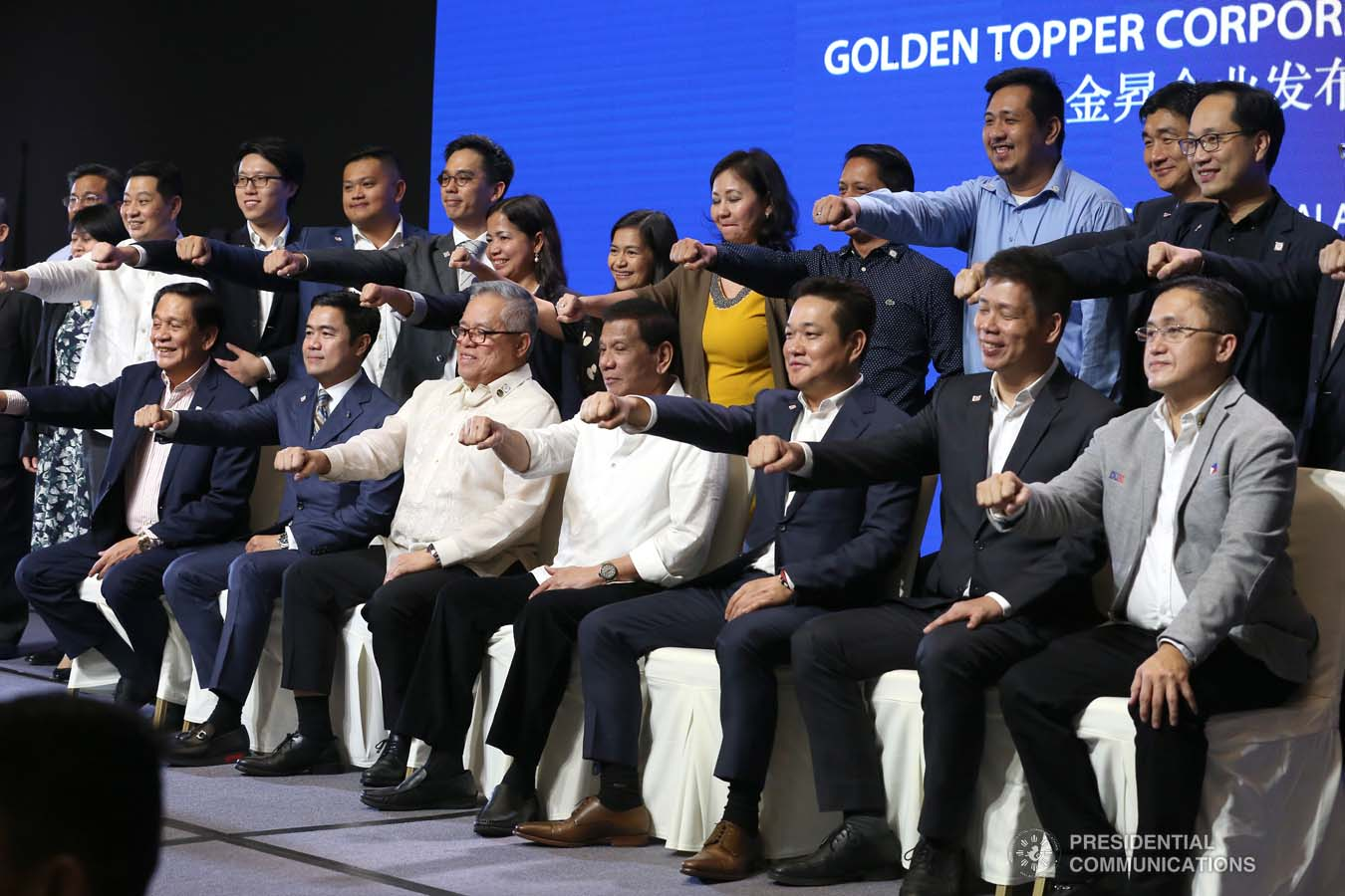 President Rodrigo Roa Duterte flashes his signature pose with the officials of the Golden Topper Group Inc. and other distinguished guests during the Golden Topper Corporate Launch at the Aseana Business Park in Parañaque City on September 25, 2019. ALBERT ALCAIN/PRESIDENTIAL PHOTO