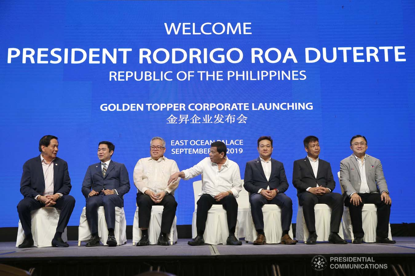 President Rodrigo Roa Duterte is joined on stage by Trade and Industry Secretary Ramon Lopez, the officials of the Golden Topper Group Inc., and other distinguished guests during the Golden Topper Corporate Launch at the Aseana Business Park in Parañaque City on September 25, 2019. ALBERT ALCAIN/PRESIDENTIAL PHOTO