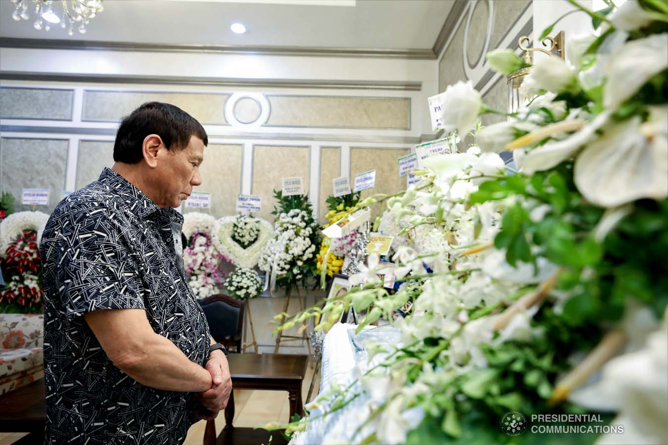 President Rodrigo Roa Duterte pays his last respects to Evelio Boiser as he visits the wake at the Cosmopolitan Funeral Homes in Davao City on September 26, 2019. KARL NORMAN ALONZO/PRESIDENTIAL PHOTO