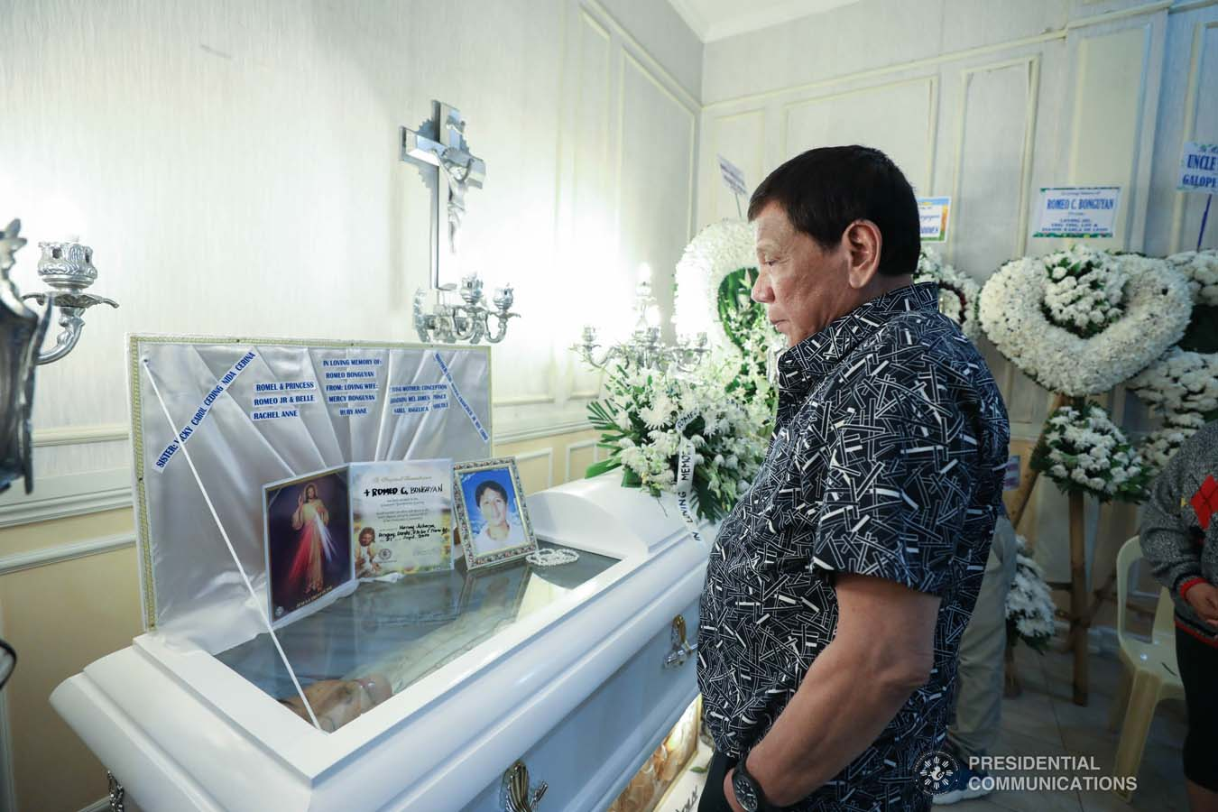 President Rodrigo Roa Duterte pays his last respects to Romeo Bonguyan as he visits the wake at the Cosmopolitan Funeral Homes in Davao City on September 26, 2019. KARL NORMAN ALONZO/PRESIDENTIAL PHOTO