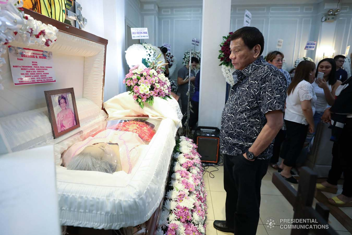 President Rodrigo Roa Duterte pays his last respects to Cresencia Josol as he visits the wake at the Cosmopolitan Funeral Homes in Davao City on September 26, 2019. RICHARD MADELO/PRESIDENTIAL PHOTO