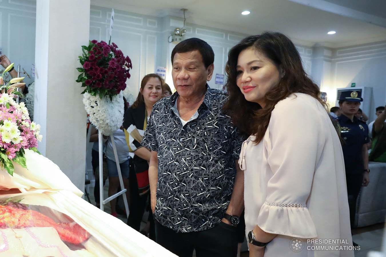 President Rodrigo Roa Duterte and his partner Cielito Avanceña pay their last respects to Cresencia Josol as they visit the wake at the Cosmopolitan Funeral Homes in Davao City on September 26, 2019. RICHARD MADELO/PRESIDENTIAL PHOTO