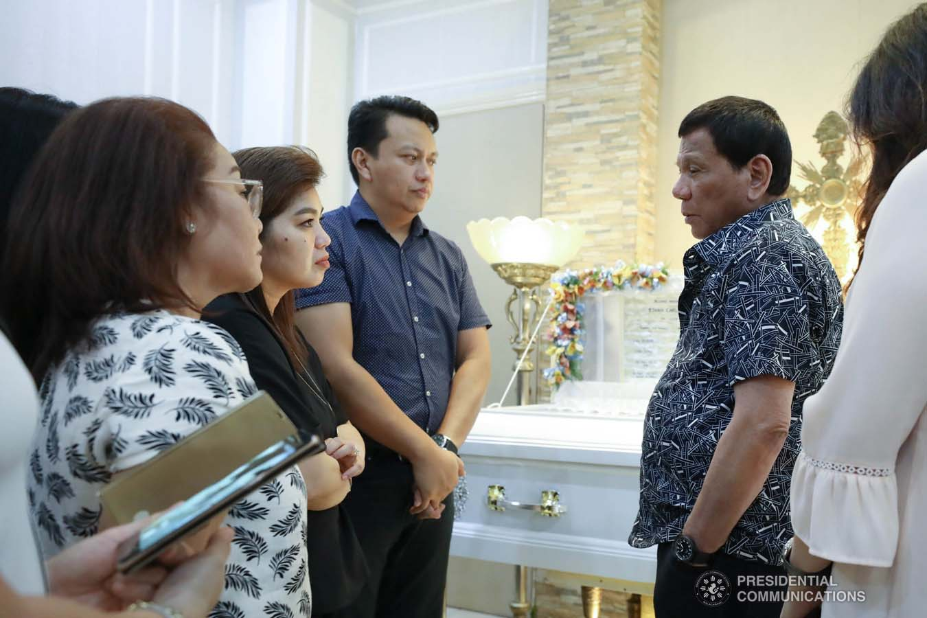 President Rodrigo Roa Duterte condoles with the family of Ethan Dabi as he visits the wake at the Cosmopolitan Funeral Homes in Davao City on September 26, 2019. RICHARD MADELO/PRESIDENTIAL PHOTO