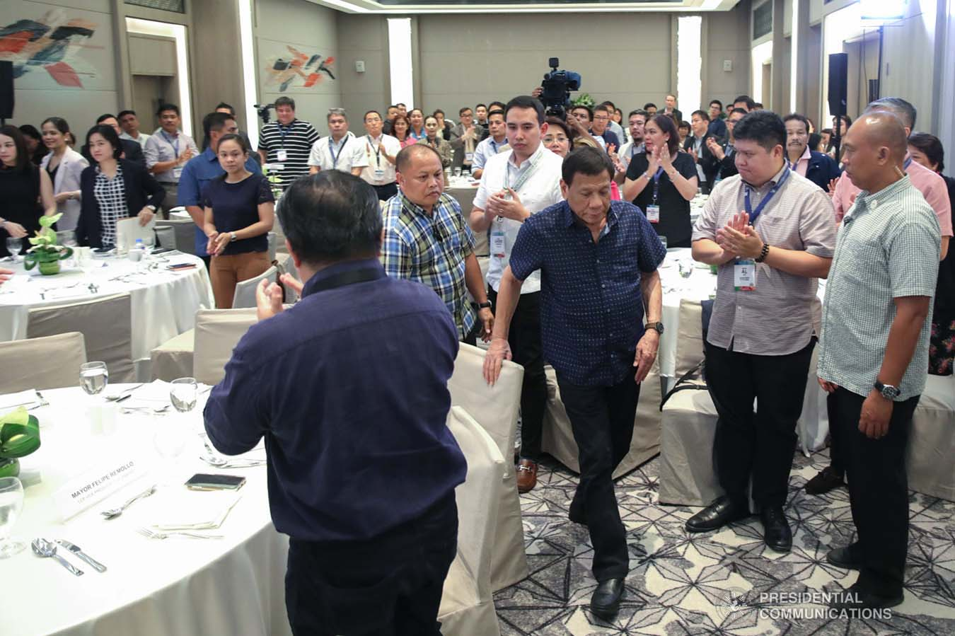 President Rodrigo Roa Duterte heads over to the stage to deliver his speech during the 69th National Executive Board Meeting of the League of Cities of the Philippines at the DusitD2 Davao Hotel in Davao City on September 27, 2019. ROBINSON NIÑAL JR./PRESIDENTIAL PHOTO