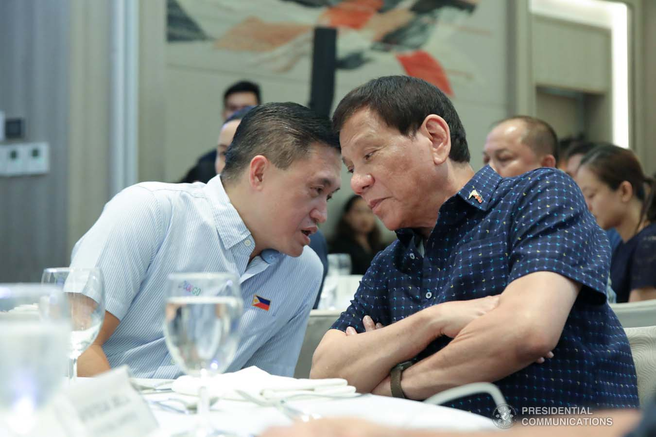 """President Rodrigo Roa Duterte chats with Senator Christopher """"Bong"""" Go on the sidelines of the 69th National Executive Board Meeting of the League of Cities of the Philippines at the DusitD2 Davao Hotel in Davao City on September 27, 2019. ROBINSON NIÑAL JR./PRESIDENTIAL PHOTO"""