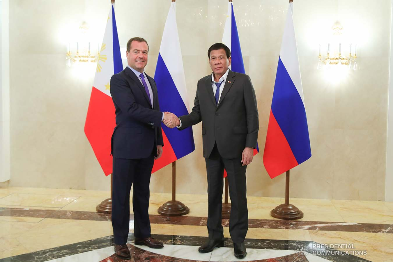 President Rodrigo Roa Duterte and Russian Prime Minister Dmitry Medvedev pose for posterity prior to the start of their bilateral meeting at the Prime Minister's Office in Moscow on October 2, 2019. ROBINSON NIÑAL JR./PRESIDENTIAL PHOTO