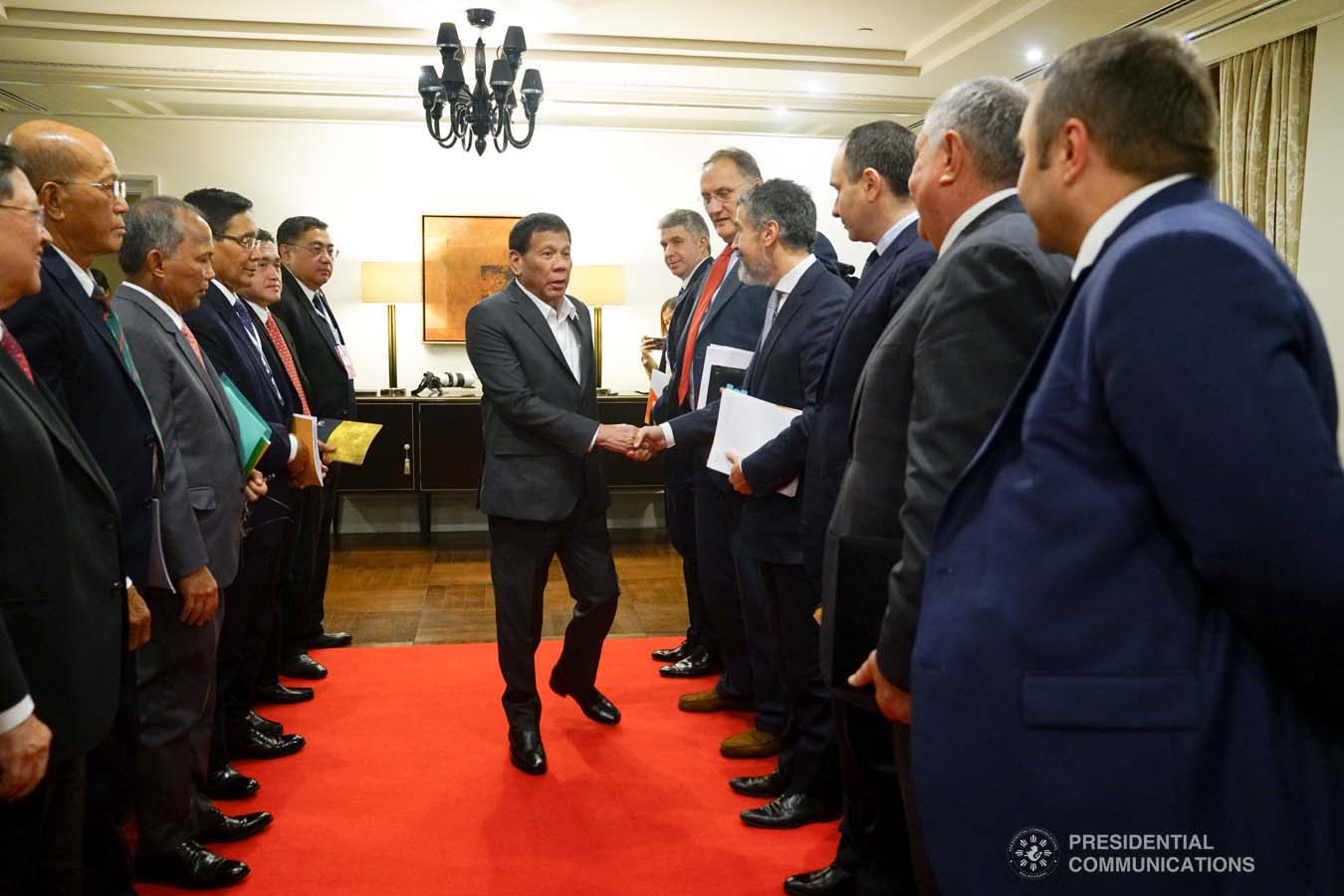 President Rodrigo Roa Duterte greets the officials of Rosneft Oil Co. led by its CEO Igor Sechin, who paid a courtesy call on the President at the Four Seasons Hotel in Moscow, Russia on October 2, 2019. JOEY DALUMPINES/PRESIDENTIAL PHOTO