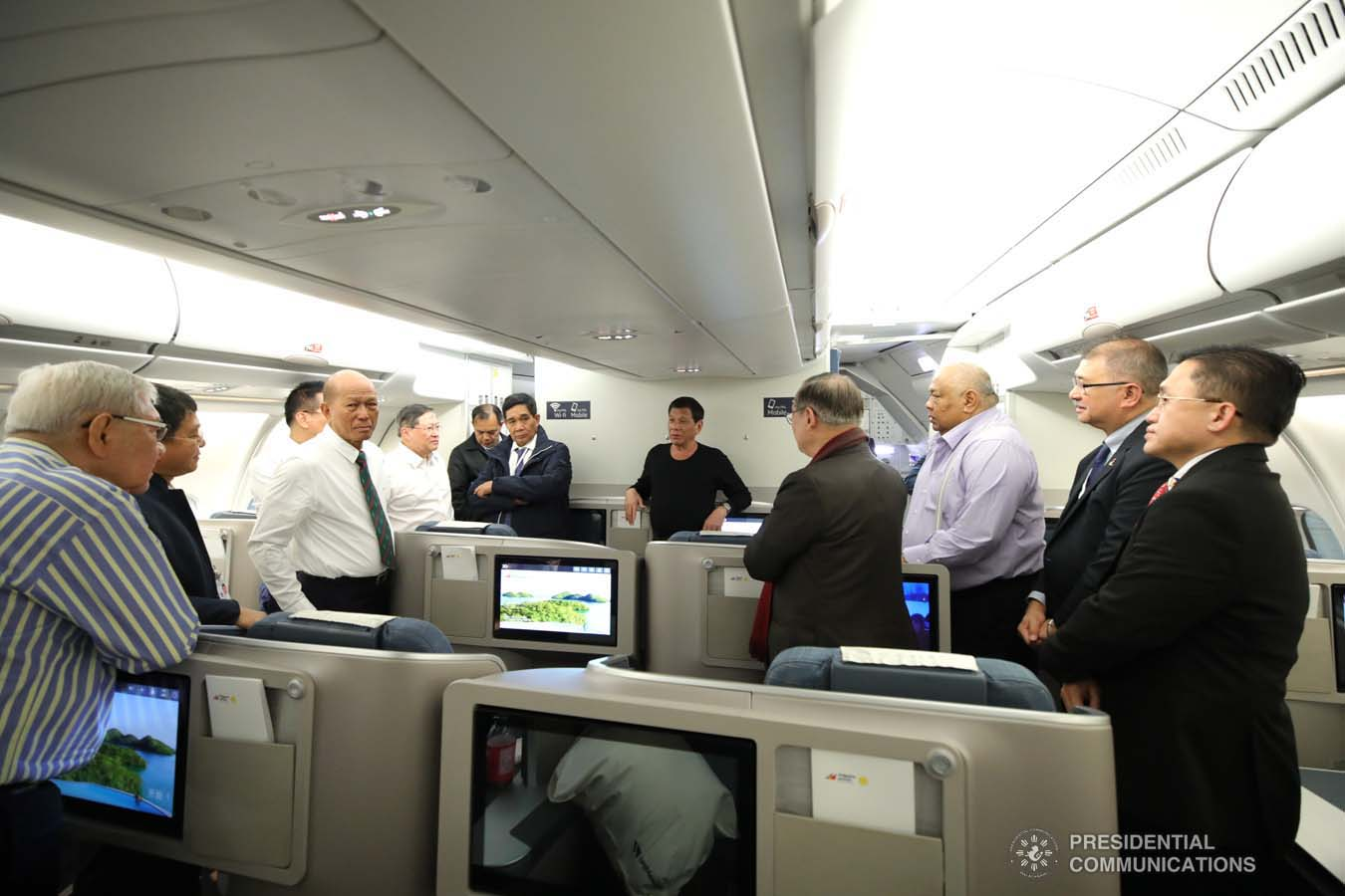 President Rodrigo Roa Duterte discusses matters with the members of his delegation while on board a plane bound for Sochi, Russia on October 2, 2019. KING RODRIGUEZ/PRESIDENTIAL PHOTO