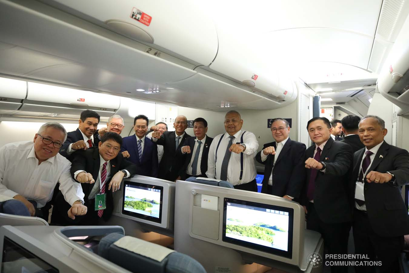 President Rodrigo Roa Duterte strikes his signature pose with the members of his delegation while on board a plane back to Moscow, Russia following his successful engagements in Sochi on October 3, 2019. KING RODRIGUEZ/PRESIDENTIAL PHOTO