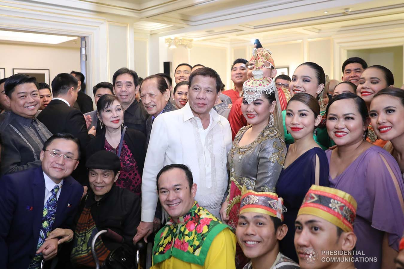 President Rodrigo Roa Duterte poses for posterity with some of the performers during the Philippine Cultural Gala Performance at the Four Seasons Hotel in Moscow, Russian Federation on October 4, 2019. ALFRED FRIAS/PRESIDENTIAL PHOTO