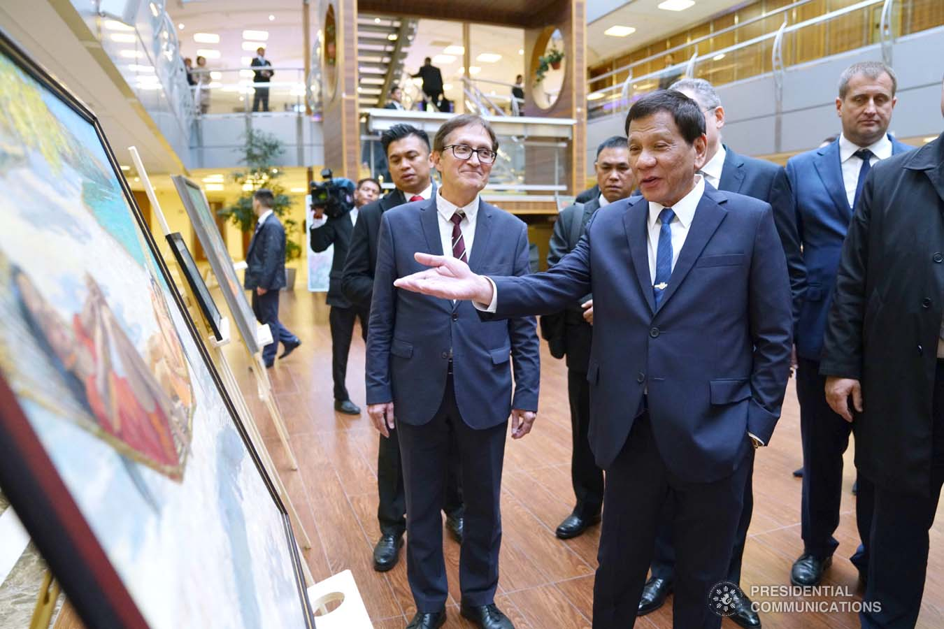 President Rodrigo Roa Duterte admires the artwork displayed during the ASEAN-Russian Exhibition at the Moscow State Institute of International Relations (MGIMO) University in Moscow, Russian Federation on October 05, 2019. JOEY DALUMPINES/PRESIDENTIAL PHOTO