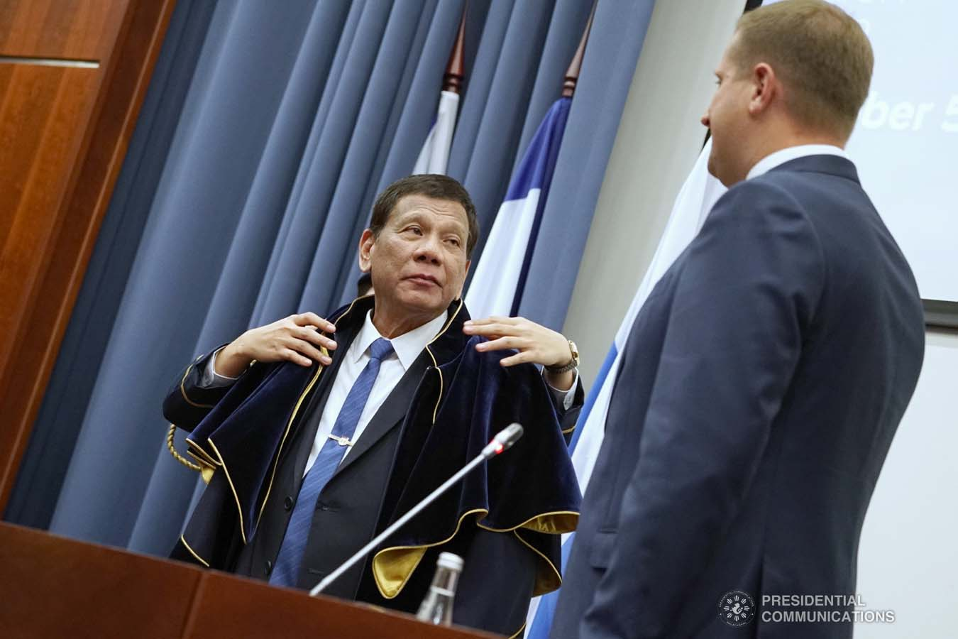 President Rodrigo Roa Duterte dons the robe and toga after receiving an honorary doctorate degree diploma from Moscow State Institute of International Relations (MGIMO) University Vice Rector Artem Malgin during a ceremony at the MGIMO University in Moscow, Russian Federation on October 05, 2019. KING RODRIGUEZ/PRESIDENTIAL PHOTO