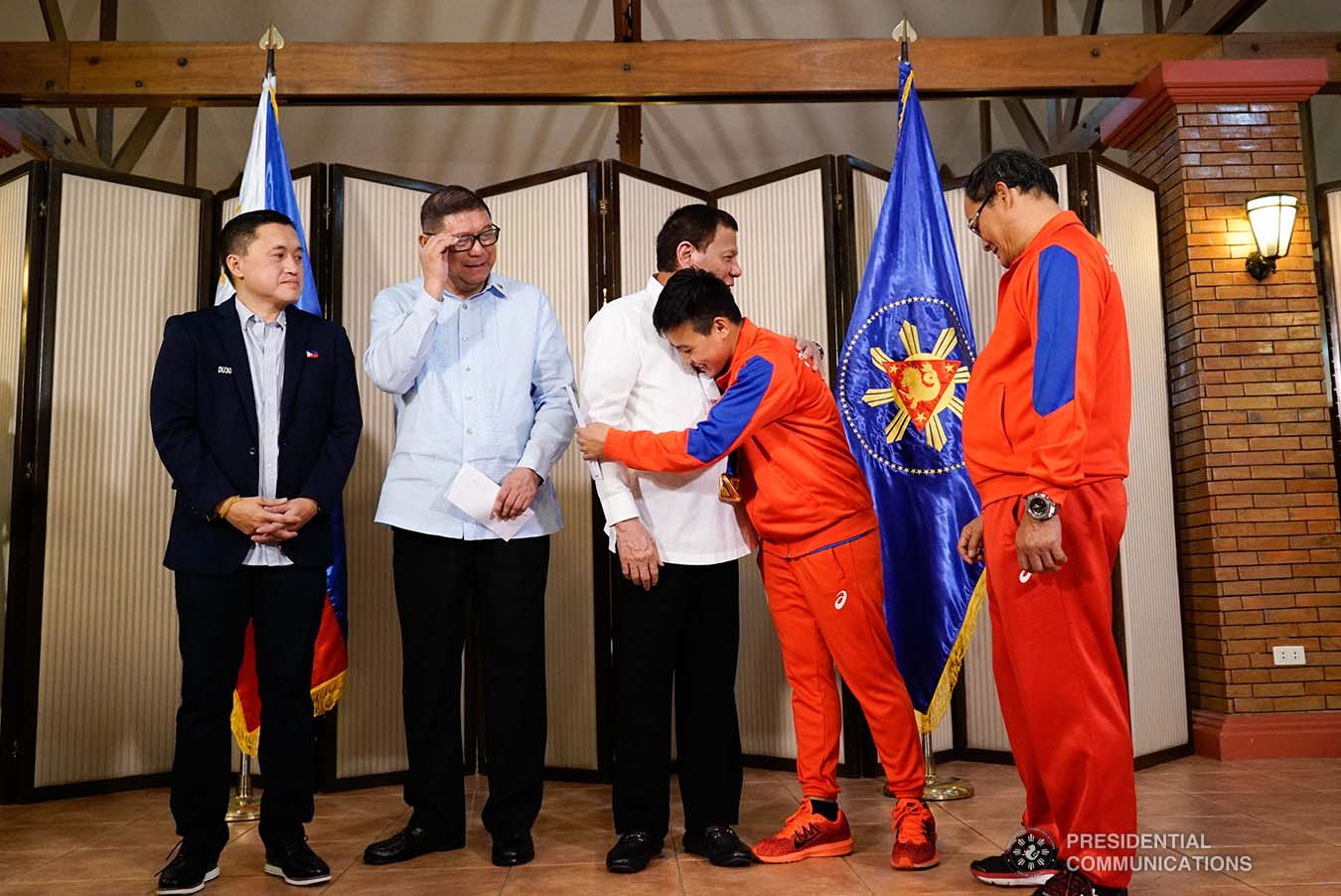 President Rodrigo Roa Duterte is embraced by 2019 AIBA Women's World Boxing Championships Gold Medalist Nesthy Petecio during their meeting at the Malago Clubhouse in Malacañang on October 16, 2019. KING RODRIGUEZ/PRESIDENTIAL PHOTO