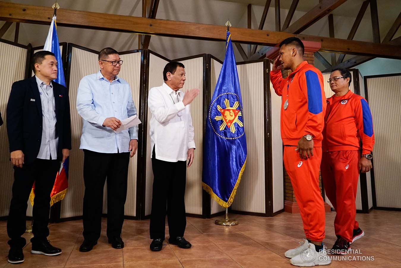 President Rodrigo Roa Duterte salutes 2019 AIBA Men's World Boxing Championships Silver Medalist Eumir Marcial during their meeting at the Malago Clubhouse in Malacañang on October 16, 2019. KING RODRIGUEZ/PRESIDENTIAL PHOTO