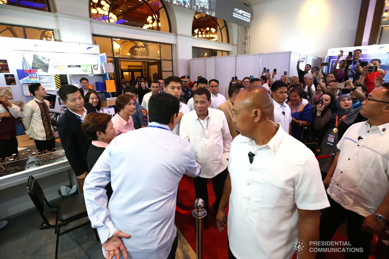 President Rodrigo Roa Duterte is greeted by one of the guests as he inspects the booths during the 45th Philippine Business Conference and Expo at The Manila Hotel on October 17, 2019. ROBINSON NIÑAL JR./PRESIDENTIAL PHOTO