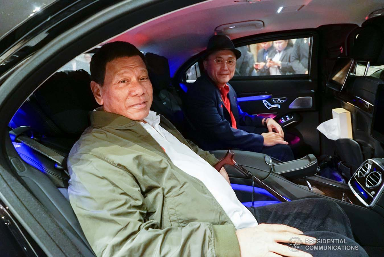 """President Rodrigo Roa Duterte and Senator Christopher """"Bong"""" Go pose for posterity while on board a vehicle going to the Haneda International Airport following the President's attendance to the Ceremonies of the Accession to the Throne of His Majesty Emperor Naruhito at the Imperial Palace on October 22, 2019. KING RODRIGUEZ/PRESIDENTIAL PHOTO"""
