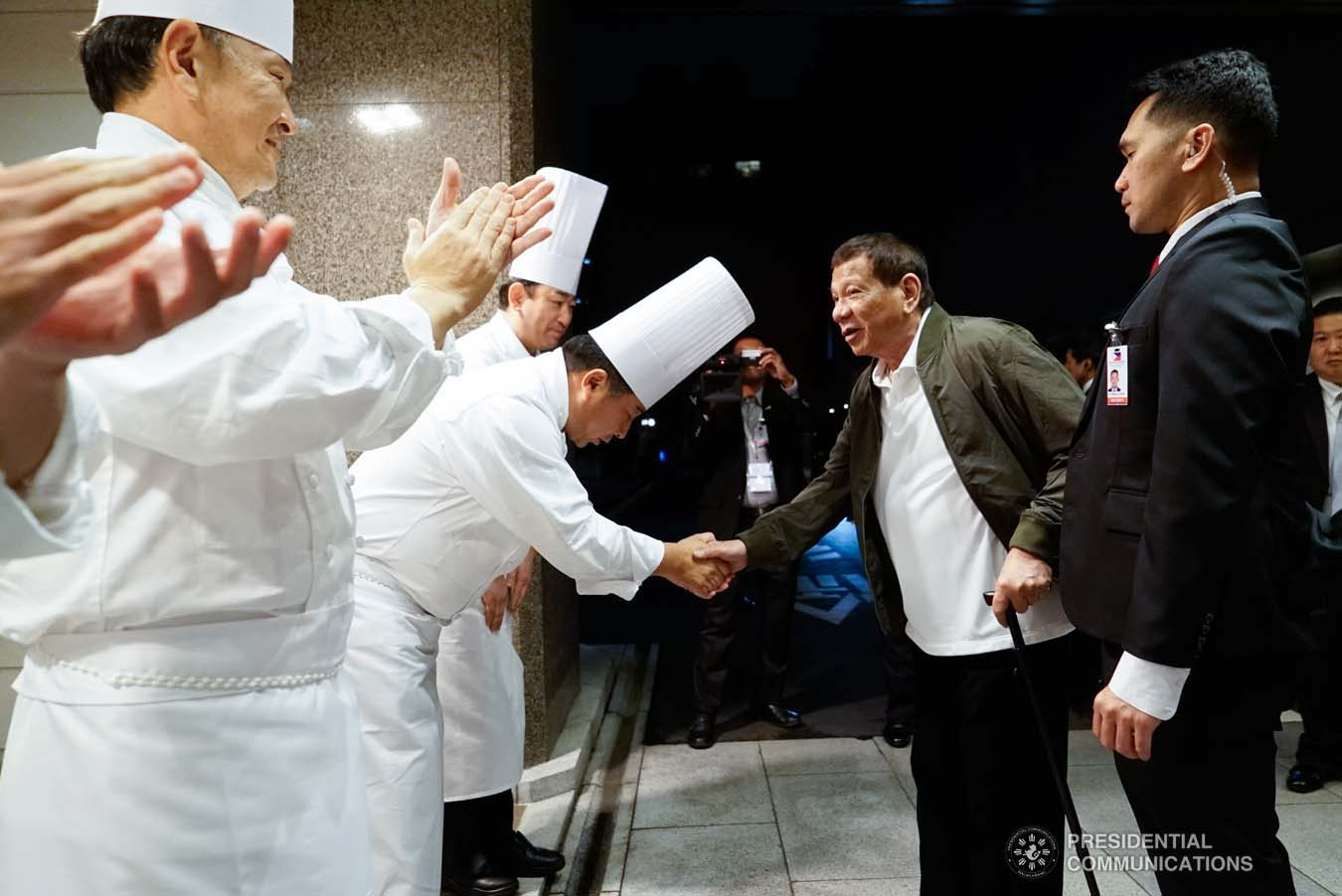 President Rodrigo Roa Duterte bids farewell to one of the chefs of a hotel in Tokyo, Japan before heading to the Haneda International Airport following his attendance to the Ceremonies of the Accession to the Throne of His Majesty Emperor Naruhito at the Imperial Palace on October 22, 2019. KING RODRIGUEZ/PRESIDENTIAL PHOTO