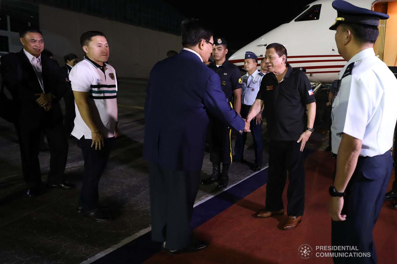 President Rodrigo Roa Duterte is welcomed back by National Security Adviser Hermogenes Esperon Jr. upon his arrival at the Villamor Air Base in Pasay City on November 4, 2019 following his successful participation in the 35th Association of Southeast Asian Nations (ASEAN) Summit and Related Summits in the Kingdom of Thailand. ROBINSON NIÑAL JR./PRESIDENTIAL PHOTO