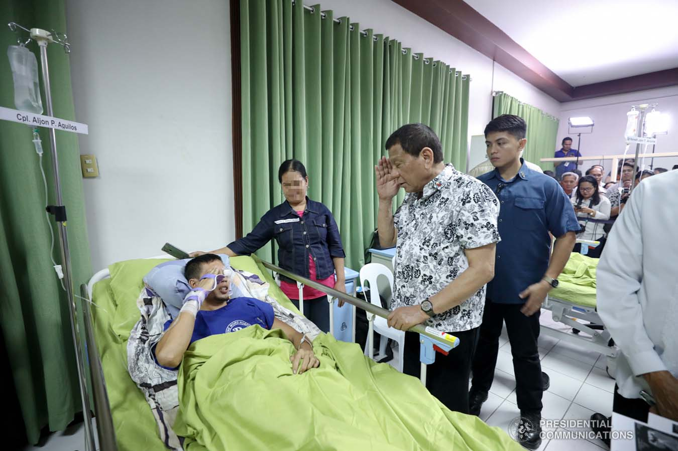 President Rodrigo Roa Duterte salutes one of the wounded law enforcers he visited at the Divine Word Hospital in Tacloban City on November 15, 2019. ACE MORANDANTE/PRESIDENTIAL PHOTO