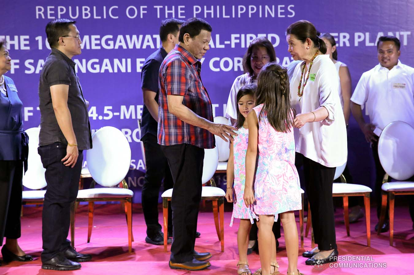 President Rodrigo Roa Duterte shares a light moment with some of the children in attendance during the inauguration of the 105-Megawatt Coal-Fired Power Plant Phase 2 of Sarangani Energy Corporation and the launch of the 14.5-Megawatt Hydropower Project of Siguil Hydro Power Corporation in Maasim, Sarangani Province on November 22, 2019. SIMEON CELI JR./PRESIDENTIAL PHOTO