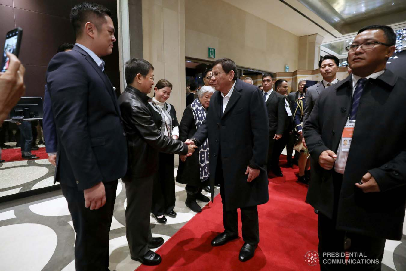 President Rodrigo Roa Duterte is welcomed by Interior and Local Government Secretary Eduardo Año and other members of the Philippine delegation upon his arrival at a hotel in Busan, Republic of Korea on November 25, 2019. ROBINSON NIÑAL JR./PRESIDENTIAL PHOTO