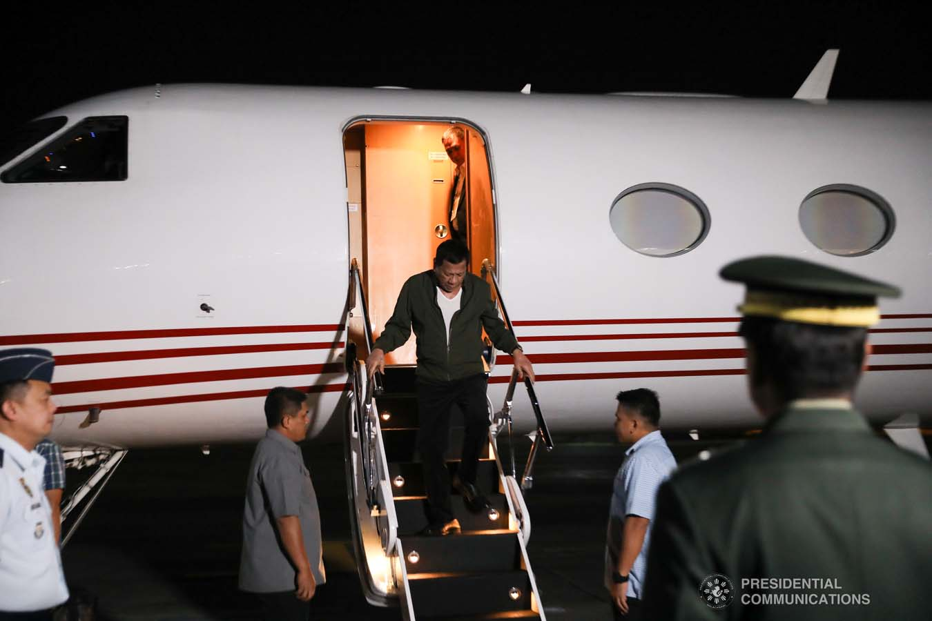 President Rodrigo Roa Duterte disembarks from a plane upon his arrival at the Villamor Air Base in Pasay City on November 26, 2019 after his successful participation in the Association of Southeast Asian Nations (ASEAN)-Republic of Korea Commemorative Summit in Busan. ALFRED FRIAS/PRESIDENTIAL PHOTO