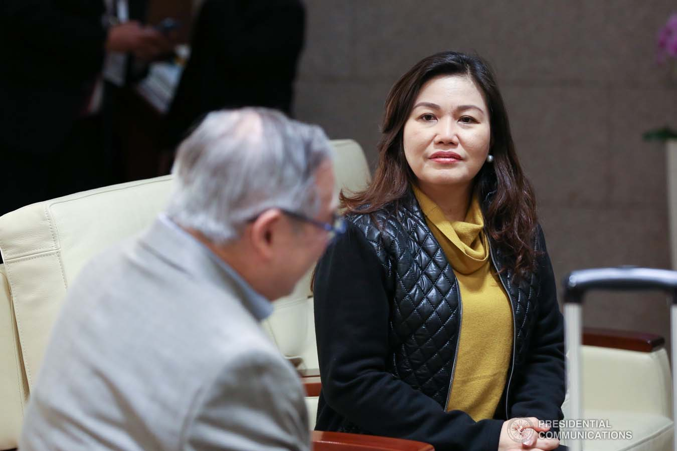 President Rodrigo Roa Duterte's partner Cielito Avanceña chats with Foreign Affairs Secretary Teodoro Locsin Jr. as she prepares to leave for Manila after joining the President in various events during the Association of Southeast Asian Nations (ASEAN)-Republic of Korea Commemorative Summit in Busan on November 26, 2019. RICHARD MADELO/PRESIDENTIAL PHOTO