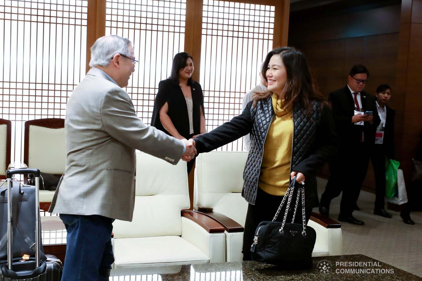 President Rodrigo Roa Duterte's partner Cielito Avanceña bids farewell to Foreign Affairs Secretary Teodoro Locsin Jr. as she prepares to leave for Manila after joining the President in various events during the Association of Southeast Asian Nations (ASEAN)-Republic of Korea Commemorative Summit in Busan on November 26, 2019. RICHARD MADELO/PRESIDENTIAL PHOTO