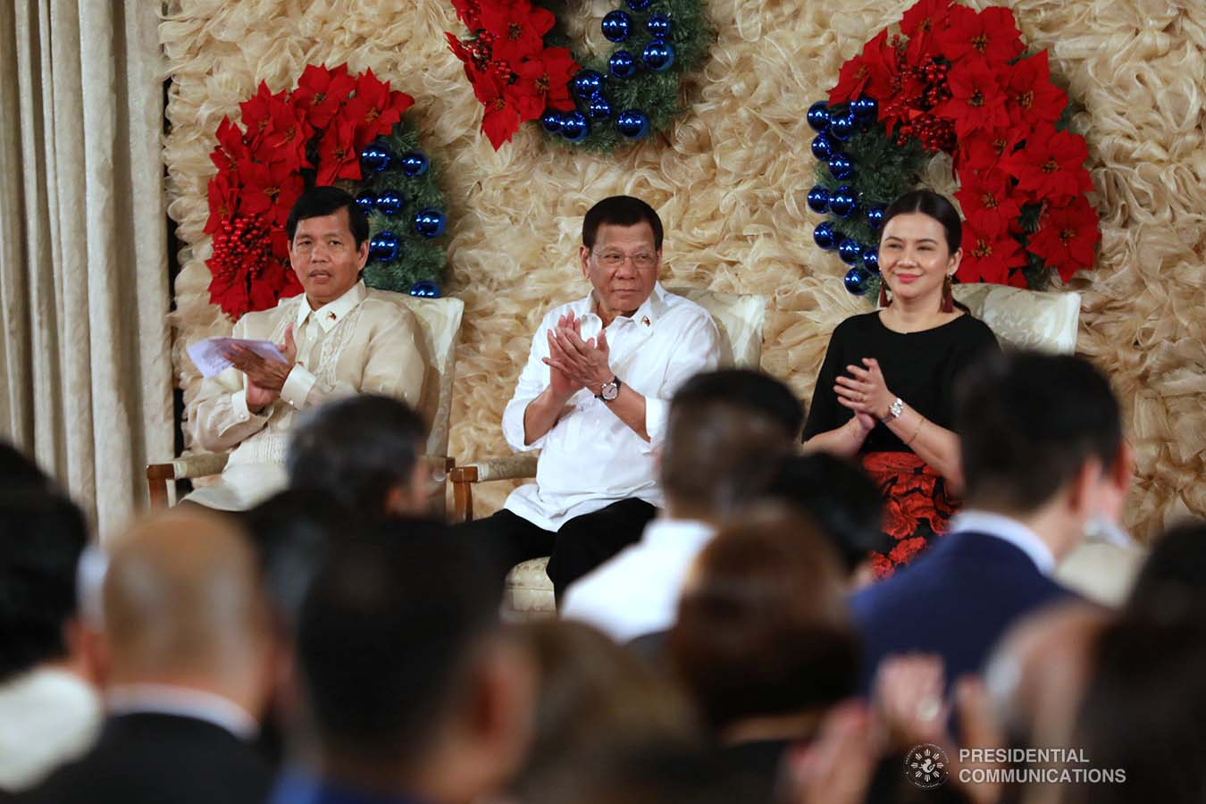 President Rodrigo Roa Duterte applauds while witnessing the program proper during the awarding ceremony for the 2018 Presidential Award for Child-Friendly Municipalities and Cities (PACFMC) at the Malacañan Palace on November 28, 2019. With the President are Social Welfare and Development Secretary Rolando Bautista and Council for the Welfare of Children (CWC) Executive Director Mary Uy. ACE MORANDANTE/PRESIDENTIAL PHOTO