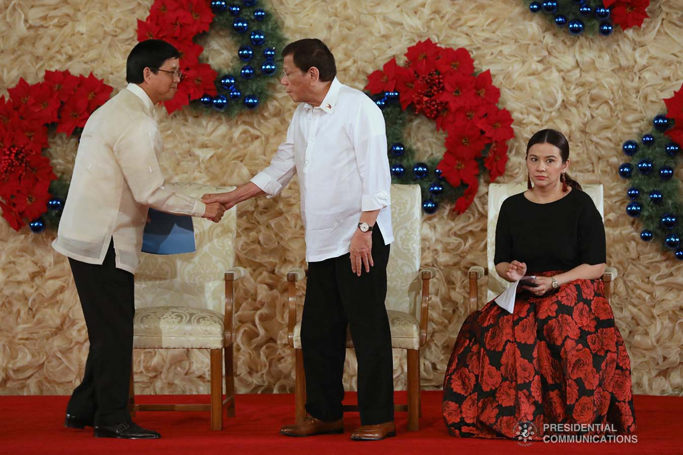 President Rodrigo Roa Duterte greets Social Welfare and Development Secretary Rolando Bautista after the latter gave his welcome remarks during the awarding ceremony for the 2018 Presidential Award for Child-Friendly Municipalities and Cities (PACFMC) at the Malacañan Palace on November 28, 2019. TOTO LOZANO/PRESIDENTIAL PHOTO