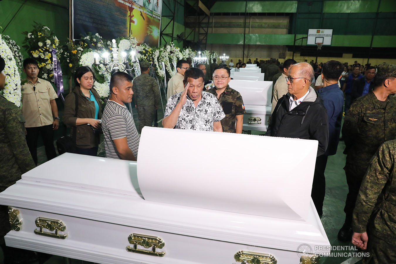 President Rodrigo Roa Duterte pays his last respects to one of the slain soldiers he visited at Camp General Vicente Lukban in Catbalogan City in Samar on November 15, 2019. ALBERT ALCAIN/PRESIDENTIAL PHOTO