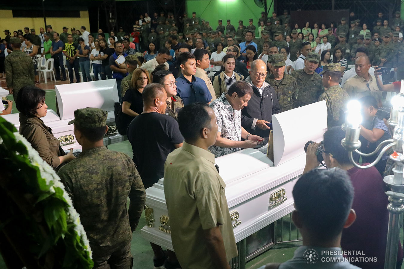 President Rodrigo Roa Duterte posthumously awards the Order of Lapu-Lapu Rank of Kalasag to one of the slain soldiers he visited at Camp General Vicente Lukban in Catbalogan City in Samar on November 15, 2019. ALFRED FRIAS/PRESIDENTIAL PHOTO