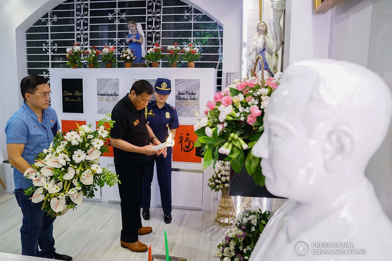 President Rodrigo Roa Duterte lights a candle to honor the memory of his mother Soledad as he visits her grave at the Roman Catholic Cemetery in Davao City on October 31, 2019. JOEY DALUMPINES/PRESIDENTIAL PHOTO