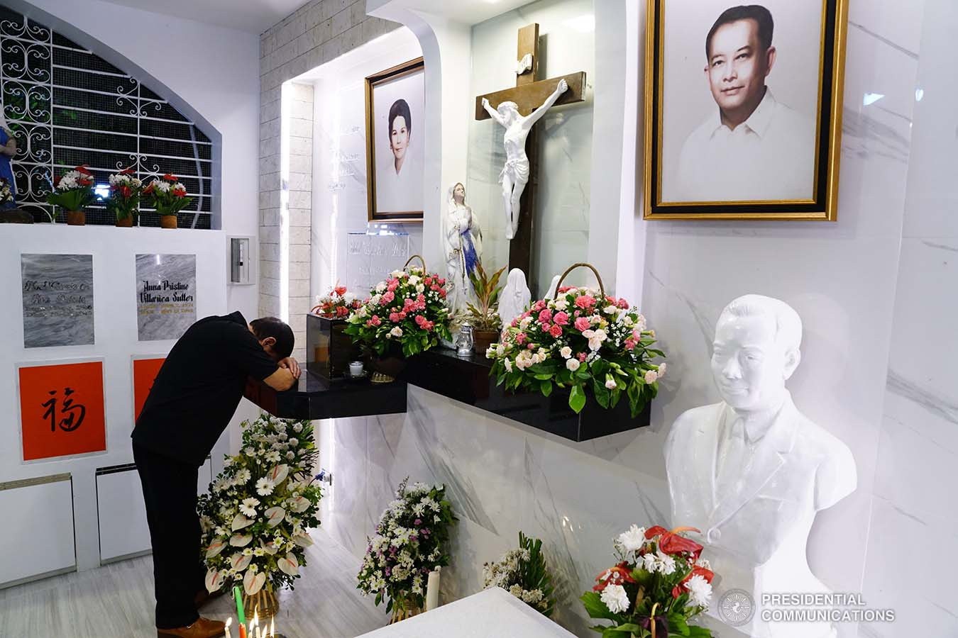 President Rodrigo Roa Duterte takes a solemn moment as he visits the grave of his mother Soledad at the Roman Catholic Cemetery in Davao City on October 31, 2019. JOEY DALUMPINES/PRESIDENTIAL PHOTO