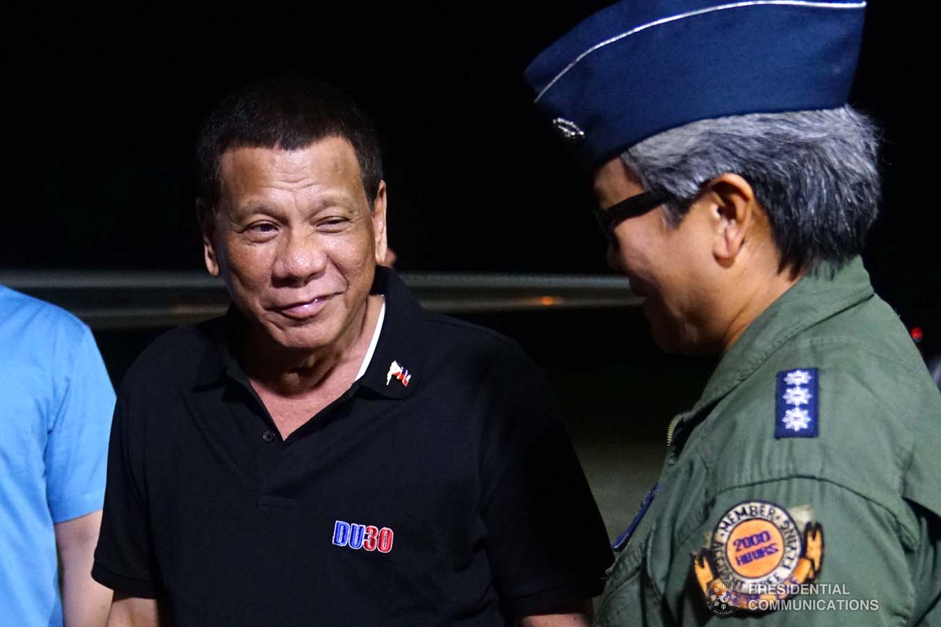 President Rodrigo Roa Duterte shares a light moment with an officer from the Philippine Air Force before boarding a plane bound for the Kingdom of Thailand at the Tactical Operations Group 11 in Davao City on November 1, 2019. JOEY DALUMPINES/PRESIDENTIAL PHOTO