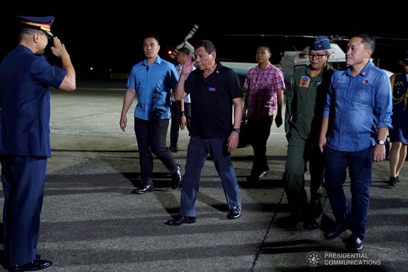 President Rodrigo Roa Duterte salutes an officer from the Philippine National Police upon his arrival at the Tactical Operations Group 11 in Davao City before boarding a plane bound for the Kingdom of Thailand on November 1, 2019. JOEY DALUMPINES/PRESIDENTIAL PHOTO