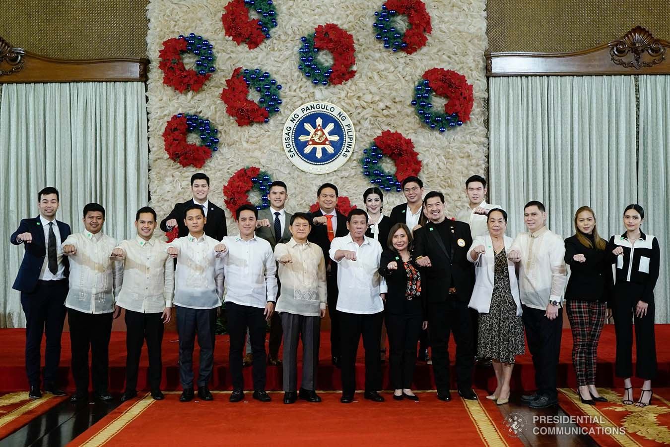 President Rodrigo Roa Duterte strikes his signature pose with the officials of the Department of Interior and Local Government during the ceremonial signing of the Postponement of the 2020 Barangay and Sangguniang Kabataan Elections Act and the Malasakit Center Act at the Malacañan Palace on December 3, 2019. KING RODRIGUEZ/PRESIDENTIAL PHOTO